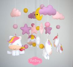 Unicorn baby mobile Nursery mobile Baby girl mobile Cot mobile Baby crib mobile Cloud mobile Baby mobile moon Pink girl mobile Stars mobile Thank you for looking! This Listing is for One Felt Unicorn nursery mobile! All these toys are made completely by hand: all the details are cut