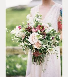 Simply gorgeous with the variety of hellebores, the roses and pieris japonica ~ we ❤ this! moncheribridals.com