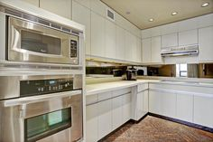 Oven and Microwave to the left, polished granite flooring, low voltage lighting, tons of counter space.