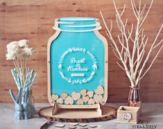 FALL SALE- Take 15% off the month of October with the code FALLINLOVE at checkout!! ----  Say I Do in Style! Creators of the Original Mason jar wedding guest books! These adorable Mason Jars are sure to be a hit! Guests will have fun signing off their well wishes on wooden hearts and dropping them in. A lovely whimsical alternative to guest book signing and makes for some interactive fun between guests! The frame is cut such that each heart slides in and sits perfectly in the frame. After…