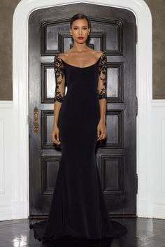 Black silk scoop neck gown w/embroidered 3/4 length sleeve by Lorena Sarbu Fall 2014