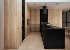 divine pale wood and black contemporary kitchen - floor to ceiling cupboards - pk-house interior design , łubki.