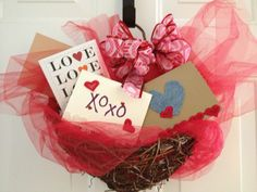 For Valentines Day: grapevine heart basket, red tulle, ribbon and some hand made cards.