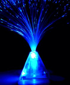 Fiber optic light- $4.88 at Save-on-Crafts.com. Would be perfect centerpieces