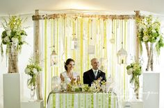 Head table backdrop with ribbons and lanterns