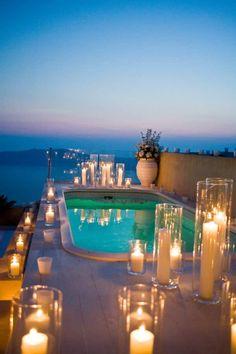 Romantic candles add an elegant touch to this Greece destination wedding! Photographer: Santorini Photo