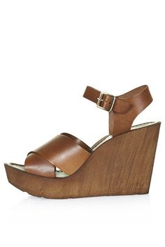 WORLDIE Wedge Sandals $75 http://us.topshop.com/en/tsus/product/new-in-this-week-2169940/new-in-this-week-70543/worldie-wedge-sandals-4009961?bi=1&ps=200