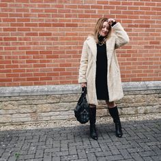How to dress for winter - dress, shearling coat and tall boots | For more style inspiration visit 40plusstyle.com