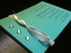 Tiffany Blue and black wedding invitations with white bow and bling  I like the simpleness...can do it in red paper, white lettering and black bow? or White paper, black lettering, red bow...bling too!