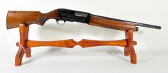 "Savage Arms Model 775A 12ga 18"".   The Savage Model 775A is similar to the Browning Auto-5, and mfg mid 20th Century. Features scroll work on each side of the receiver of a hunting scene with dogs and flying ducks. Alloy reciever, 18"" barrel, 12ga, chambered for 2¾"" shells. Serial # 245XXX. $265"