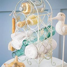 """I love """"out of the box"""" ideas like this - a wine rack for bathroom bottles and rolled towels."""