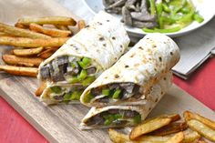Philly cheese steak wrap by Maebells is a quick and portable take on the traditional cheese steak sandwich. You can make this complete meal in less than an hour knowing full well each wrap delivers. Philly Cheese Steaks, Wrap Recipes, Beef Recipes, Cooking Recipes, Dinner Recipes, Beef Meals, Healthy Recipes, Recipies, Healthy Foods