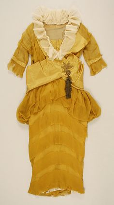 Dress    Date:      1913–14  Culture:      American  Medium:      [no medium available]  Dimensions:      [no dimensions available]  Credit Line:      Gift of Mr. John Kimball, 1945  Accession Number:      C.I.45.77.9