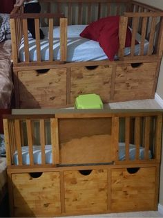 DIY toddler bed with storage and a slide in door for preventing falls while they sleep.