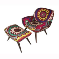 No, you're not hallucinating. We know it's rare to see such uplifting upholstery on Mid-Century designs—but it's real. In fact, we picked the fabric. This fifties-inspired armchair and stool set is brought to life with a stunning display of antique suzani textiles. By bringing vivid, traditional Eastern artistry to a sleek, modern silhouette, this pair bridges the gap between the old and the new, and fits both traditional and eclectic décor.