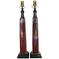A pair of beautiful tall ceramic lamps with a square wood base and gold plated metal plate.