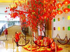 Chinese New Year: Firecrackers and noisemakers will chase away evil spirits. The fabulous dragon and lion will dance in the streets. People will wear red, the most auspicious of colors, and red envelopes with lucky money will be given to children. Tangerines are often given for good luck, but odd numbers are unlucky, so the tangerines are given in pairs. The third day of the new year is the day the mice marry off their daughters, so people go to bed early, so they don't disturb the mice.