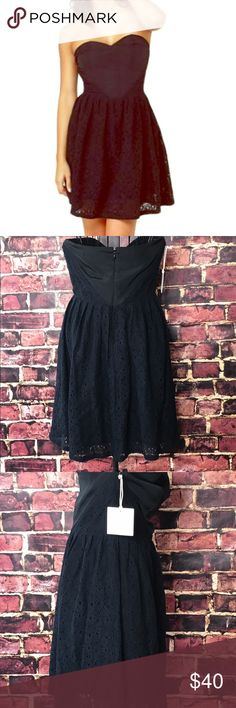 NWT!BB DAKOTA BY JACK COLINA STRAPLESS BLACK DRESS NWT! Size 4. BB DAKOTA BY JACK COLINA STRAPLESS BLACK DRESS.  A sweetheart-shaped woven bodice arrives true to form with seamed cups and diagonal boning front and back. Black floral lace sneaks up along the sides, then free-falls from waistline into a full skirt. Invisible back zipper/hook clasp. Fully lined. BB Dakota Dresses Strapless