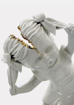 Maria Rubinke creates deformed and bloody porcelain doll figures.