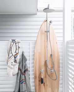 our petite roundie and poncho, hanging dry after a trip to the beach. AND what a ideal spot for our soap on a rope. #thebeachpeople #shower #outdoorshower #surfboard #surf #towel #kids #petite #beachtowel #poncho