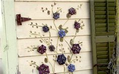 Would love to make this on a piece of wood, lean against house on side where Iris are growing.  Garden Art: Faucet handle flowers | Flea Market Gardening