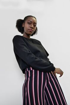Calling all casual Queens! This crop sweater is the ultimate go to clothing accessory for an edgy dress down look . Features an ultra soft inner and full length sleeves. Pair with your favourite leggings and takkies for an ultimate athleisure look. Made in South Africa Edgy Dress, Embroidered Badges, Collar And Cuff, Cropped Sweater, Athleisure, Black Sweaters, South Africa, Queens, Pairs