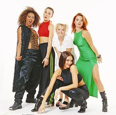 "The Spice Girls - Melanie Brown (""Scary Spice""), Melanie Chisholm (""Sporty Spice""), Emma Bunton (""Baby Spice""), Geri Halliwell (""Ginger Spice""), and Victoria Beckham, née Adams (""Posh Spice"")"