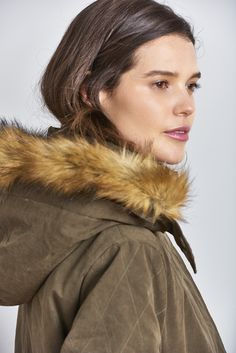 Our Quilted Parka. A classic style designed to be warm with a fleece lining, quilted sleeves and faux fur trim. Draw cord at the waist and back hem for flattering silhouette.