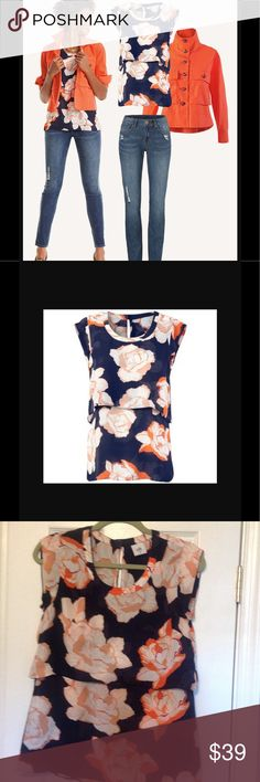 Cabi floral top XS Cabi navy blue semi sleeveless blouse covered in beautiful white blossoms edged in tiger lily and bougainvillea. Tiered, keyhole back. XS, poly, staple piece, beautiful colors CAbi Tops Blouses
