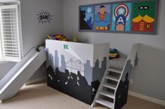 Super Hero little boy's room - maybe not with this theme but I like the interactive area, perhaps for a reading corner