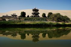 Located approximately 6 km (3.73 miles) from the outskirts of the city of Dunhuang in Western China, lies Crescent Lake, an incredible oasis in the Gobi desert. Known as Yueyaquan in Chinese, the crescent-shaped lake is a major tourist attraction where one of the world's great shrines to Buddhism resides.