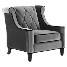 Add an elegant touch to your living room seating group or den decor with this timeless wood arm chair, showcasing tufted velvet upholstery in grey.