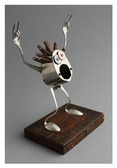 Assembled/found object robot sculpture by Brian Marshall.
