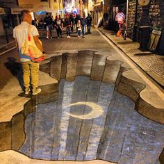 Oh my god there is a hole in the street! #notteceleste in Bagno di Romagna #myer_streetart - Instagram by @n_montemaggi