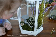 """""""I found this decorative lantern, and we created a twist on a fairy garden for my daughter's fairy-themed room: a fairy guest house! We removed all the glass to make it less breakable and used fake plants and preserved moss with our miniatures."""" Look at her enchanting fairy garden!"""
