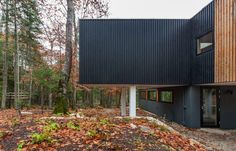 This home in the woods of Wisconsin was originally built as a single, open-plan volume by Salmela Architect, and subsequently extended on three occasions to fit its occupants needs.