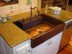 copper kitchen sink a container of water in the container and granite kitchen countertop