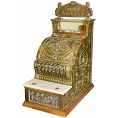 This small but beefy (80 pound) beauty from National Cash Register is the 313 Candy store model, introduced in 1911. Its ornate brass and nickel carvings and finish make it one of the most desirable of the early registers.
