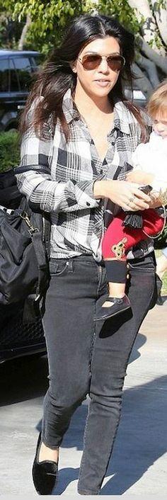Who made  Kourtney Kardashian's white plaid shirt, gray skinny jeans, black handbag, aviator sunglasses, and velvet loafer shoes?