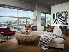 Ultra contemporary industrial bedroom with modern design & exotic animal prints on the walls