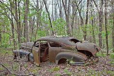 Old car in the woods...looks like the old shootin car from my youth
