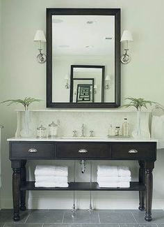 I have always wanted a double vanity with lots of counter space and a sink for my husband, but I would make do with a gorgeous vanity like this!  Love the grey slate floors as well.