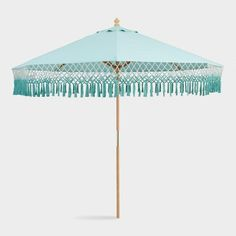 Decor/accessories - Infuse your alfresco space with a luxurious, bohemian vibe with our exclusive outdoor umbrella. With an open weave and ombre fringe, this aqua-hued canopy . Aqua, Market Umbrella, Patio Umbrellas, Patio Furniture Sets, Outdoor Furniture, Outdoor Living, Outdoor Decor, New Home Designs, World Market