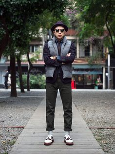 Get this look: http://lb.nu/look/7916502  More looks by P-Jay Chen: http://lb.nu/pj19821020  Items in this look:  Uniqlo Wool Gentry Hat, Ray Ban Sunglasses, Uniqlo Wool Down Vest, Uniqlo Wool Blazer, Uniqlo Necktie, Uniqlo Denim Shirts, Orient Watch, Leather Wristband, Uniqlo Trousers, Uniqlo Socks, Dr. Martens Wingtip Shoes