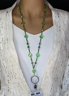 This glass & crystal beaded lanyard includes black with metallic green glass twist tube beads, peridot green aurora borealis faceted coin Lanyard Necklace, Seed Bead Necklace, Diy Necklace, Necklaces, Glass Crystal, Crystal Beads, Jewelry Patterns, Bracelet Patterns, Beaded Jewelry