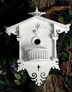 The intricate woodwork on this birdhouse is worthy of a nightingale, but much appreciated by the sparrow.
