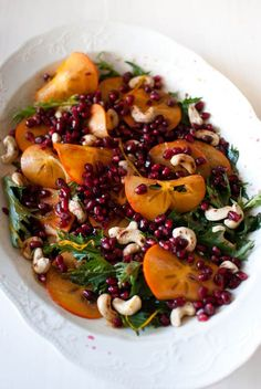 Mizuna, persimmon and pomegranate salad with orange dressing. Perfect for Thanksgiving or Christmas dinner menus.