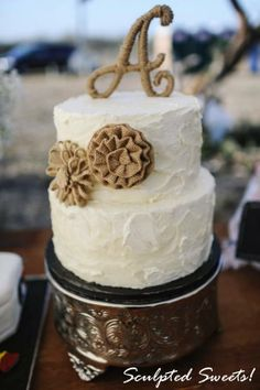 Textured buttercream wedding cake with burlap. This was actually picked up and I was so nervous with the heat! But they loved it and it got there perfectly thank goodness!