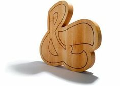 """House Industries Ampersand Cutting Boards . $120.99. The Ampersand Cutting Board allows you to transition easily from chopping to serving while looking effortlessly chic. Perfect for dinner parties, the Ampersand Cutting Board is available in two sizes to accommodate any gathering. Designer: House Industries Materials: Solid Maple Butcher Block Dimensions: Small - 12"""" x 12"""" x 1.5"""" Large - 18"""" x 18"""" x 1.5"""""""