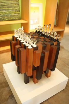 Collaborative functional abstract chess board privately commissioned. Wood base built and designed by Reagan Johns. Features 32 borosilicate glass pieces on cedar with hidden pull out draws for storing each piece